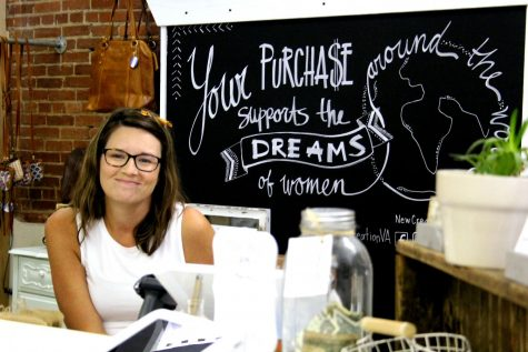 Volunteer coordinator and shop manager Christina Swecker greets customers with a smile at New Creation. The business is located in the Agora Market of downtown Harrisonburg.