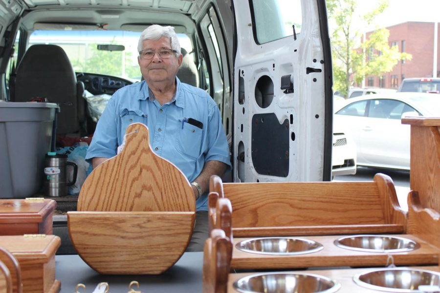 Woodworker Jim Dellinger, resting as his goods are displayed at the Farmers Market in downtown Harrisonburg.