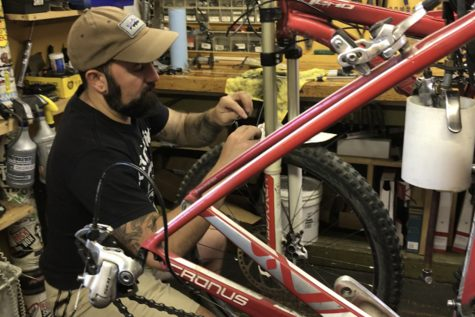 Shenandoah Bicycle Company mechanic Chris Regec works on a bicycle in shop.