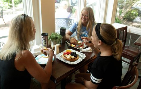 Andrea, Sophie and Kate Weaver enjoy breakfast at Heritage Bakery for the first time.