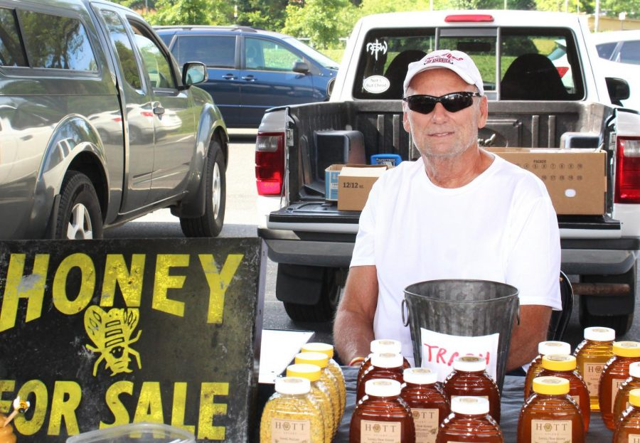 Ted Hott goes to the Farmers Market every Tuesday and Saturday to sell Hott Apiary honey products. They have 50 hives on their farm, and make all of their products, such as lotions, chapsticks, and balms. Photo by Nina Alabanza from JMU jCamp.