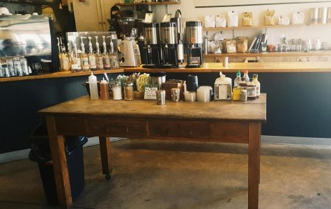 This photograph shows the table where customers can get some plain coffee and come to the table and spice it up.