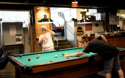 Jeanie Baker and Chase Jones play pool together in the arcade. Ruby's has multiple pool tables throughout the restaurant and arcade.