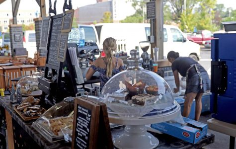 Heather Benin and her daughter Ella prepare coffee at Sugar Bean and Baking Company located at the Farmers Market.